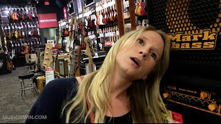 Girl in a Guitar Store