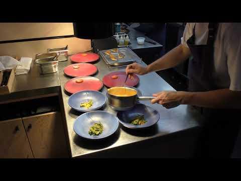 Busy kitchen service at 1 Michelin star restaurant Ikoyi in London, United Kingdom