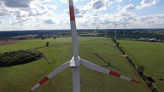 Wind farm from the air with Nordex, Enercon and Vestas wind turbines 9/2016