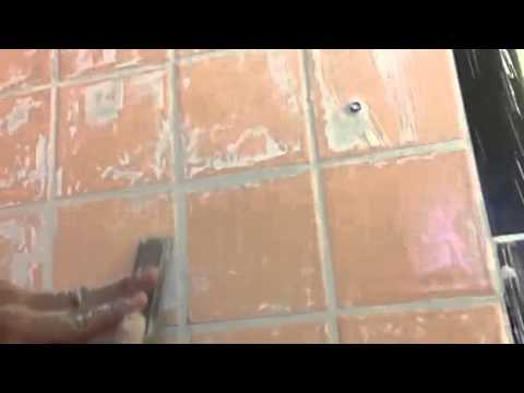 how to remove dried grout form the tile