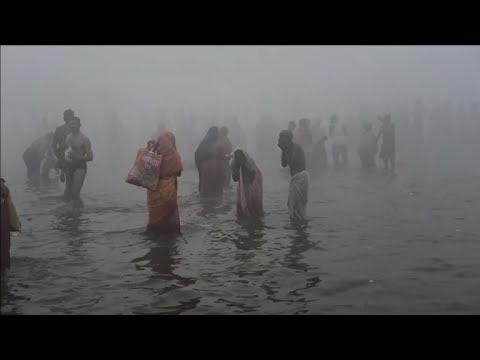 Hindu pilgrims take a holy bath in the Ganges