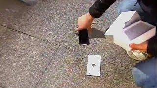 видео Первый владелец iPhone 6 в городе Перт уронил его на асфальт во время интервью (новости)