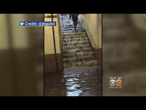 Waterfall Covers Hamilton Heights Subway Station Stairs