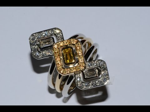 Fancy yellow diamond mounted on gold handmade ring