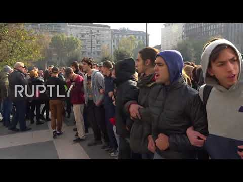 Italy: Scuffles as students face police during education law protest in Milan
