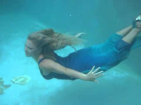 @TrinaMason plays in a dress underwater in a pool in the rain