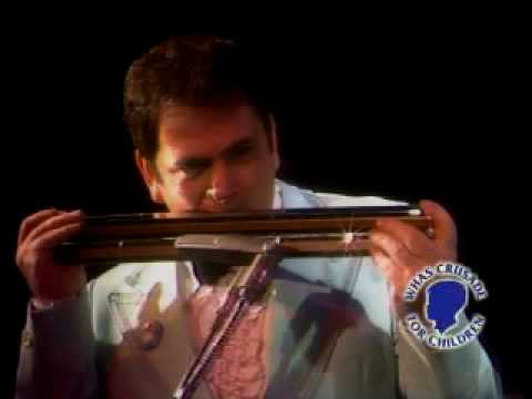Dueling harmonica Srgo Brothers in 1984 classic clip