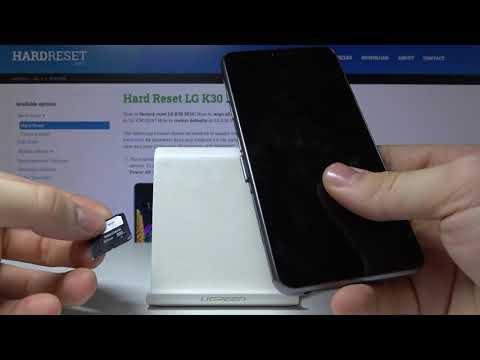 LG K30 2019 Как вставить карту памяти и карту SIM в телефон LG K30 2019