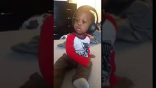 Toddler surprised by headphone music