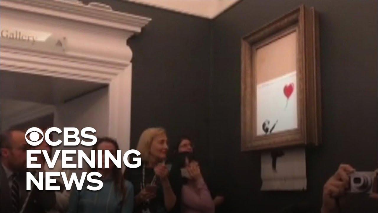 Banksy painting self destructs after $1 4 million sale
