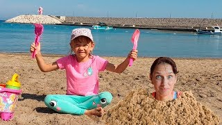 Alena has a Fun Day on the Beach! Plying with Mom and Sand