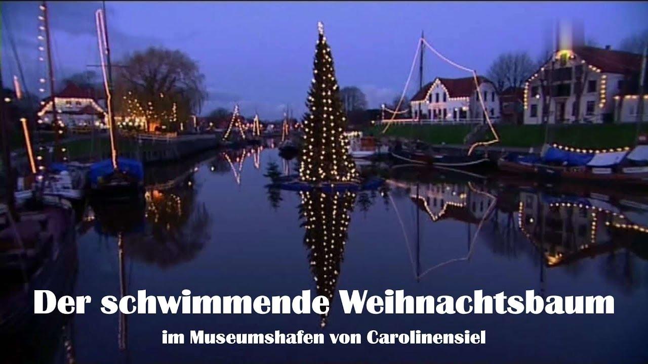 Schwimmender Weihnachtsmarkt.Carolinensiel Schwimmender Weihnachtsbaum Und Lichtermeer Im Museumshafen