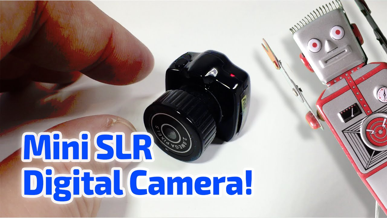 MINI SLR DIGITAL CAMERA WORKING MINIATURE by Guinness - YouTube