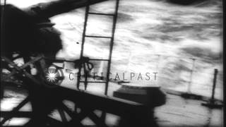 Allied Forces drop depth charges on a German submarine and force her to surface i...HD Stock Footage