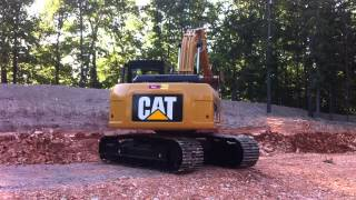 Playing on a Cat 315D L Excavator