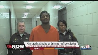 Man caught dancing on burning roof faces judge