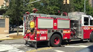 FDNY ENGINE 241 RETURNING TO QUARTERS ON 3RD AVENUE IN BAY RIDGE AREA OF BROOKLYN IN NEW YORK CITY.