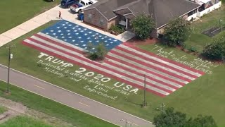 Giant American flag, 'TRUMP 2020' painted on home's lawn