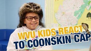 A DEAD RODENT?! 😱 WVU KIDS REACT TO COONSKIN CAP 🤣