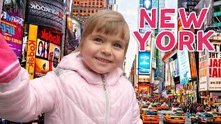 Оливия играет на Таймс-сквер Нью-Йорк и катается на лошадке в центральном парке