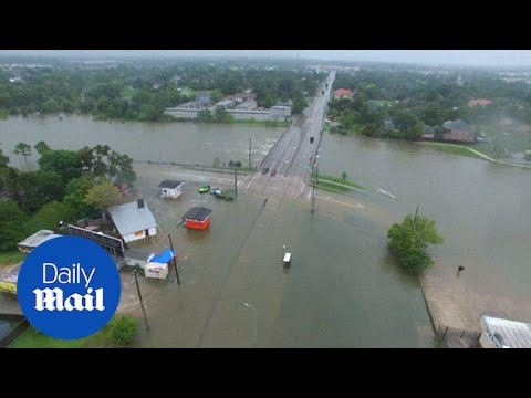 Drone video captures the incredible scale of flooding in Houston - Daily Mail