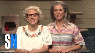 Barbara DeDrew (Kate McKinnon) and Furonica (Kristen Wiig) show off the cats available for adoption during the Thanksgiving Catacopia giveaway. [Season 42 ...