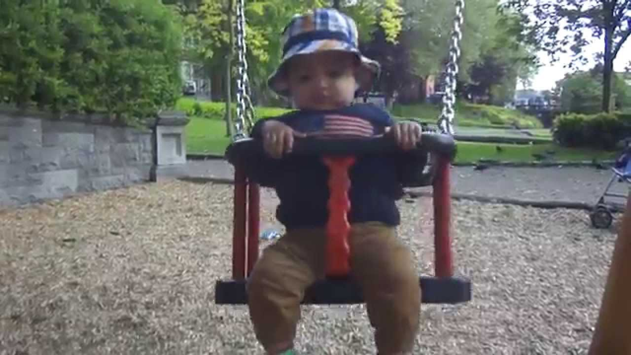 Baby Playing On Swing 8 Month Old