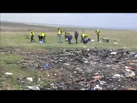 Investigators on MH17 Crash Site: Experts search debris field to find remains of last two victims