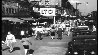 Traffic and pedestrians along Myrtle Avenue in Brooklyn, New York. Sidewalk displ...HD Stock Footage