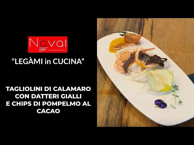 Tagliolini di Calamaro su coulis di datterini gialli e chips di pompelmo con cacao.