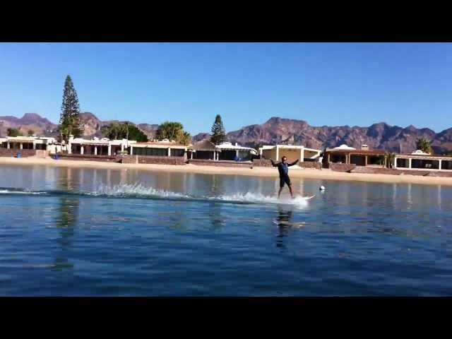 Wake-boarding because there's no wind to Kiteboard
