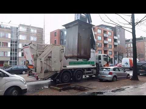 Garbage truck in Amsterdam using a crane
