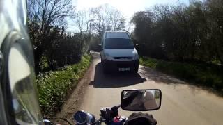 Motorcycle hit by van