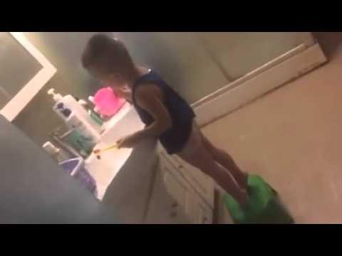 Cute a little man clean his own teeth