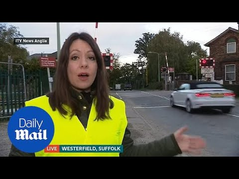 Audi driver jumps red light at level crossing on live news Suffolk