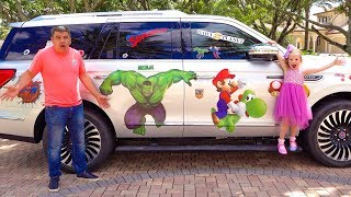 Nastya decorated papa's car with superheroes