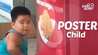 Little Boy Eats Pasta From A Poster