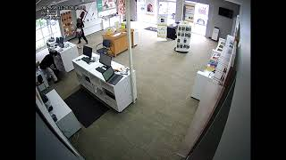 Surveillance video: Armed robbery at cell phone store (1of2)