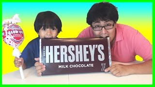 GIANT HERSHEY CHOCOLATE BAR with GIANT LOLLIPOP Eggs Surprise Toys Disney Cars Minions Shopkins(Giant hershey chocolate bar and giant lollipop with Ryan and his family from Ryan ToysReview! It was so much fun doing a candy review video on giant candy ..., 2016-09-16T12:00:04.000Z)