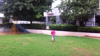 Lasya Gugu playing in grass Thumbnail