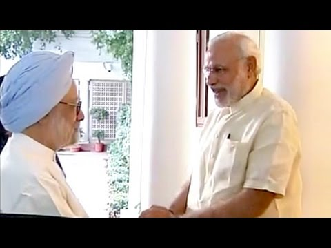 PM Modi meets Manmohan Singh at 7 RCR