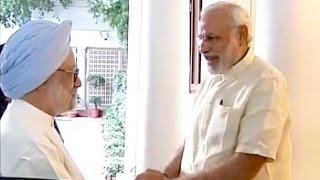 pm modi meets manmohan singh at 7 rcr