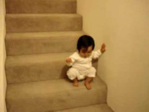 15 months old Eva going down the stairs