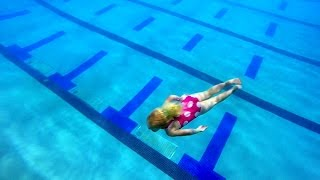 4 year old  dives off Diving Board, Swimming Around the Pool, and Diving Down Deep