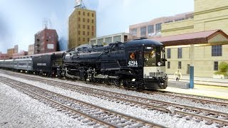 sp 4294 ac 12 pulling a very long heavyweight train in the sierras