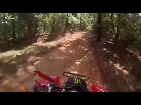 Connors first time riding the new quad on the woods course