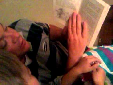 Iain gillies reading a book to his son