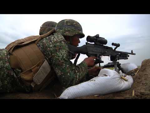 Philippine Marines and U.S. Marines and sailors fire M240B machine guns during PHIBLEX 14