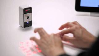 Celluon Magic Cube - World's only virtual projection keyboard and multi-touch mouse(Like us on: http://www.facebook.com/celluon How it works: http://celluon.com/technology_how_it_works.php Available at ..., 2011-06-29T03:50:10.000Z)