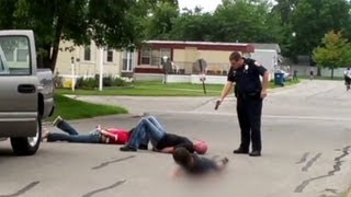 See Officer Pull Taser On Entire Family